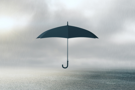 Umbrella on dull sky background. Protection concept  스톡 콘텐츠