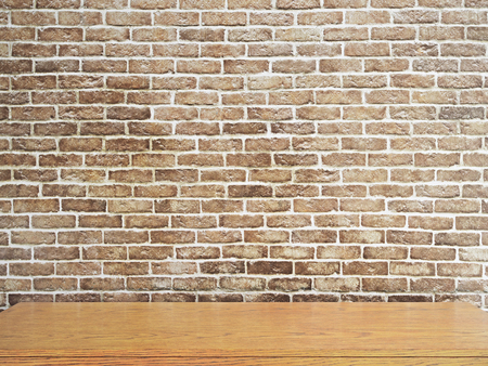 Empty wooden table on red brick wall background. Mock up, 3D Rendering