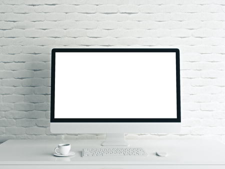 Close up of creative designer desktop with blank white computer monitor, coffee cup and keyboard on brick wall background. Mock up, 3D Rendering