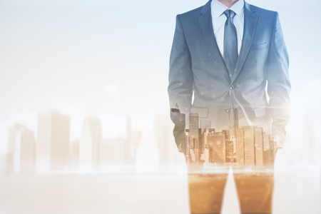 Businessman on abstract city background with copy space. Career development and finance concept. Double exposure