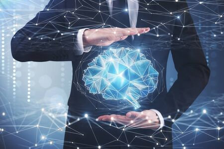Businessman holding digital polygonal brain on blurry background. Artificial intelligence and future concept. 3D Rendering  Stock Photo