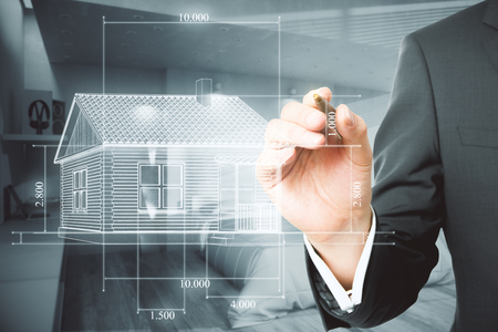 Businessman hand drawing creative house blueprint on blurry office interior background. Architect and construction concept Stok Fotoğraf - 99797113