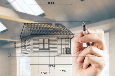 Businessman hand drawing creative house blueprint on blurry office interior background. Architect and engineering concept
