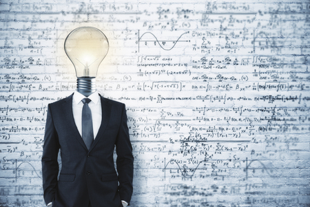 Light bulb headed businessman on concrete background with mathematical formulas. Science and solution concept