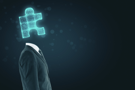 Side view of puzzle headed businessman standing on abstract background with copy space. Teamwork concept