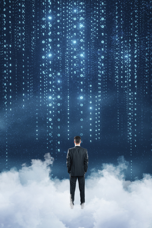 Back view of young businessman standing on abstract cloud sky background. Dream and innovation concept Stockfoto