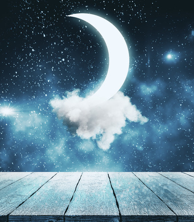 Creative moon in starry sky background. Imagination and dreams concept