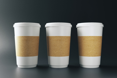 Empty three white paper coffee cups on darl background. Take out restaurant and ad concept. Mock up, 3D Rendering