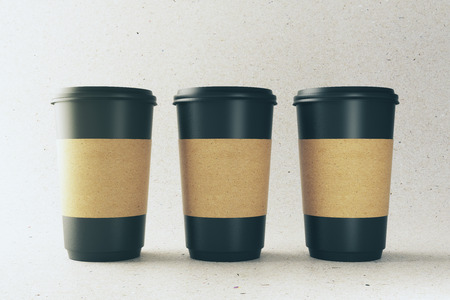 Empty three black coffee cups on light background. Take out restaurant and ad concept. Mock up, 3D Rendering  版權商用圖片