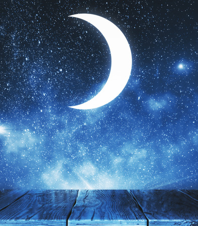 Creative moon in starry sky backdrop. Imagination and dreams concept  Standard-Bild