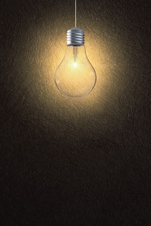 Glowing light bulb on dark wall background with copy space. Idea and success concept. 3D Rendering  Stok Fotoğraf