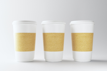 Blank three white paper coffee cups on light background. Take out restaurant and ad concept. Mock up, 3D Rendering