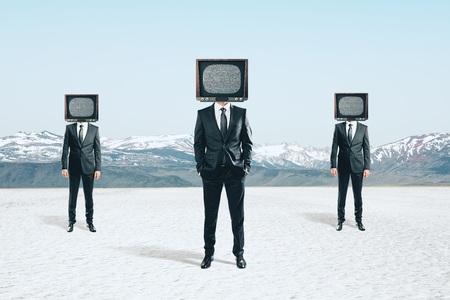 TV headed businessmen standing on abstract landscape background. Brainwash and manipulation concept