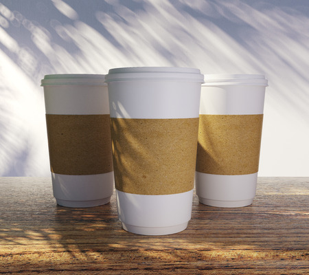 Empty white take away coffee cups with palm tree shadow. Advertisement, shop and vacation concept. Mock up, 3D Rendering