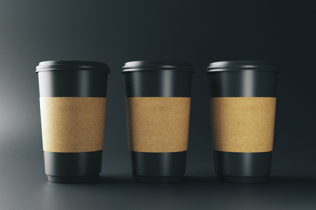 Empty three black coffee cups on dark background. Take out restaurant and ad concept. Mock up, 3D Rendering  Stok Fotoğraf