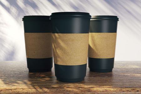 Blank coffee cups with palm tree shadows. Vacation and cafe ad concept. Mock up, 3D Rendering