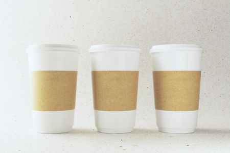 Empty three white paper coffee cups on light background. Take out restaurant and ad concept. Mock up, 3D Rendering