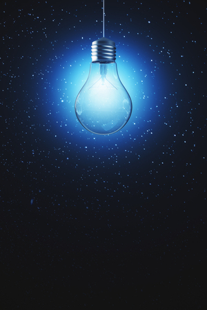 Glowing light bulb on dark wall background with copy space. Idea and innovation concept. 3D Rendering  Reklamní fotografie