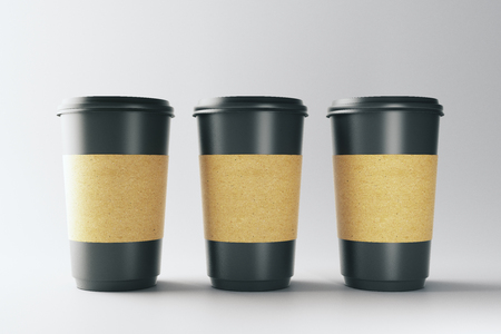 Blank three black coffee cups on light background. Take out restaurant and ad concept. Mock up, 3D Rendering