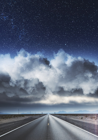Road on landscape and cloudy starry sky wallpaper. Way to success concept