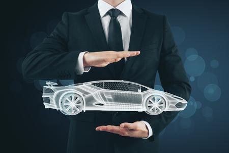 Businessman hand holding creative glowing sportscar hologram on blurry background. Transport, vehicle and engineer concept 版權商用圖片