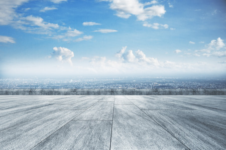 Creative concrete ground, beautiful city view and sky wallpaper