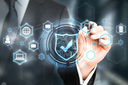 Businessman hand drawing digital antivirus interface on blurry background. Online safety concept. Double exposure