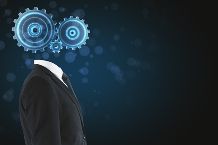 Cogwheel headed man on blurry blue background with copy space. Artificial intelligence concept Stock Photo