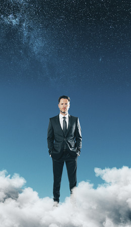 Thinking businessman in abstract starry sky with clouds. Dream and idea concept