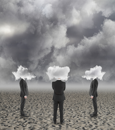 Back view of cloud headed businessmen on dull background. Confusion concept