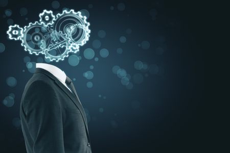Cogwheel headed businessman on blurry blue background with copy space. Artificial intelligence concept
