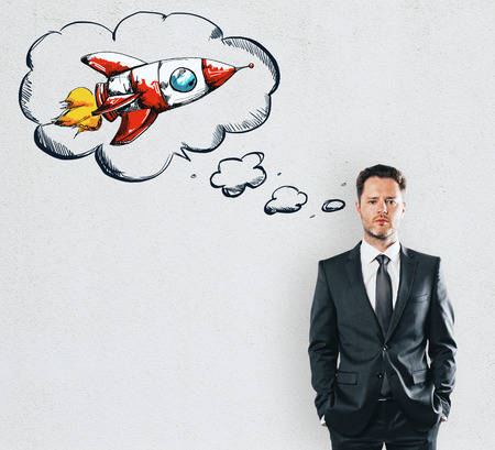 Businessman dreaming about rocket at white wall background. 3D render