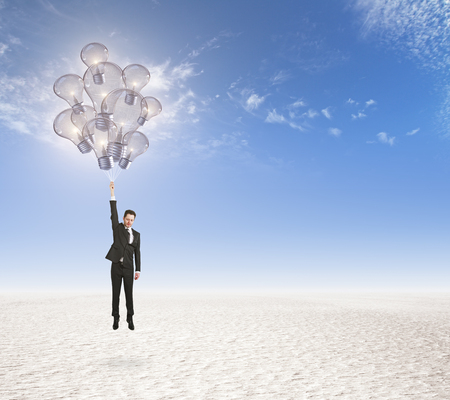 idea concept with businessman flies with bulbs like balloons at white sand with blue sky background. 3D render