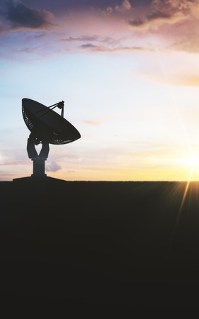 Backlit satellite plate on nature background. Broadcasting and receiver concept 스톡 콘텐츠
