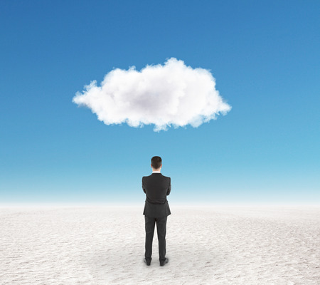 idea concept with businessman staying under cloud and trying to find a solution staying on white sand at blue sky background. 3D render Banco de Imagens