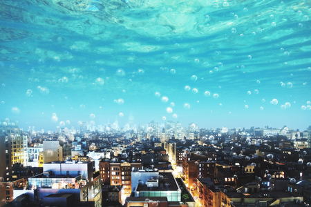 blue underwater view with bubbles on modern city with skyscrapers. 3D rendering Stock Photo