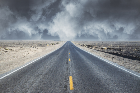 search the road concept with empty road in desert and grey cloudy sky. 3D render