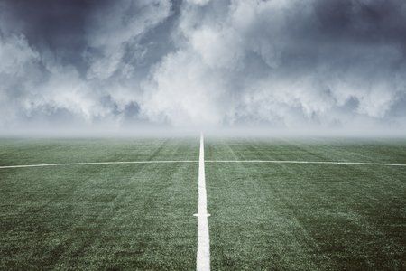 empty football field with white line in the middle and blue cloudy sky. 3D render