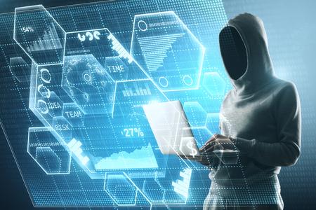 Vista lateral de un hacker sin rostro en proceso con una computadora portátil y una gran pantalla digital con ilustración de blockchain. Foto de archivo