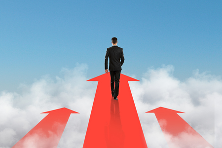 goal achievement concept with businessman goes in the direction of the arrow at blue sky background. 3D render