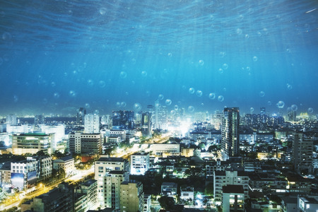underwater view with bubbles on modern city with skyscrapers. 3D rendering