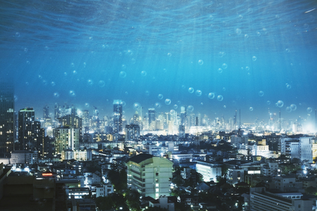 dark underwater view with bubbles on modern city with skyscrapers. 3D rendering Standard-Bild