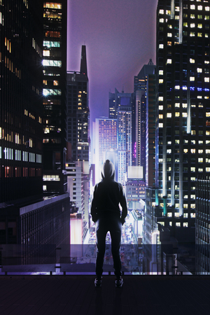back view on hacker in hoody standing on roof top and looking at night megapolis skyscrapers Stock Photo