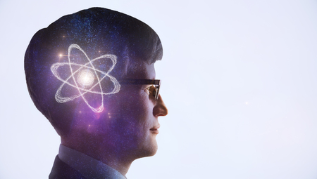 artificial intelligence concept with man head silhouette and drawn atom model inside head Stock Photo