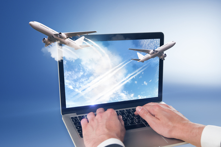 take off planes from laptop monitor and man hands at blue background Stock fotó