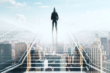 hacker back silhouette standing on the top of transparent stairs and looking at megapolis city Stock Photo