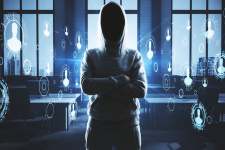 Hacker standing in abstract interior with digital business interface. Ransomware and risk concept. Double exposure