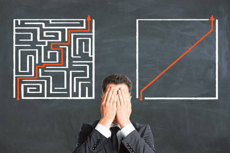 Problem and difficulty concept. Businessman with creative maze labyrinth sketch Stock Photo
