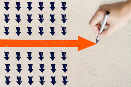 Hand drawing red arrow on concrete wall background. Leadership and success concept Stock fotó