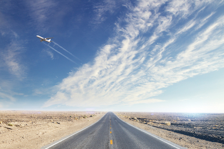 Road with taking off airplane. Travel and transport concept Stock Photo